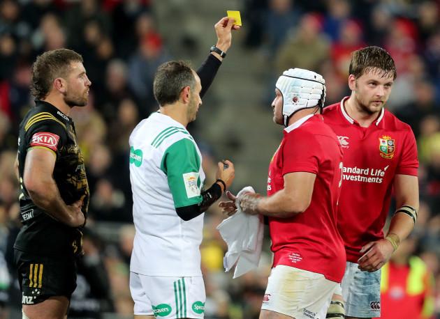 Romain Poite shows a yellow card to Iain Henderson