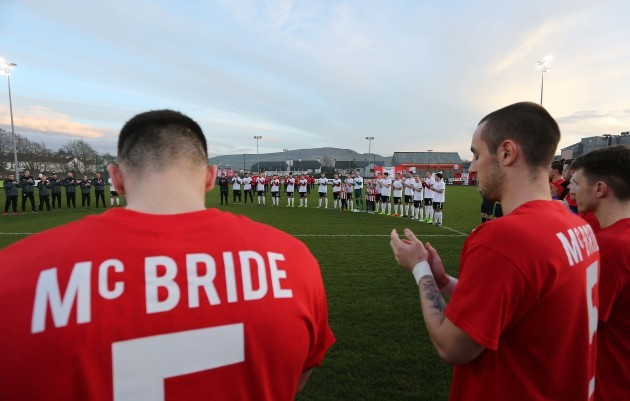 Players from both teams observe a minutes applause for late Derry City captain Ryan McBride