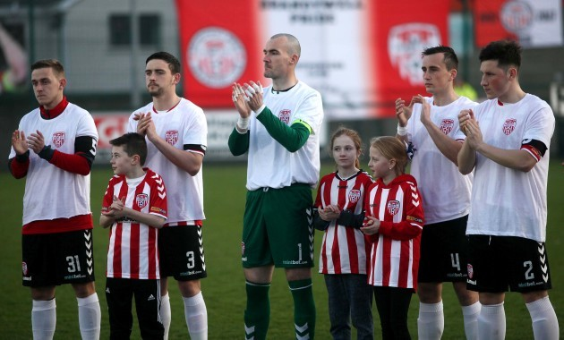 Players during the minutes applause in tribute to late Derry City captain Ryan McBride