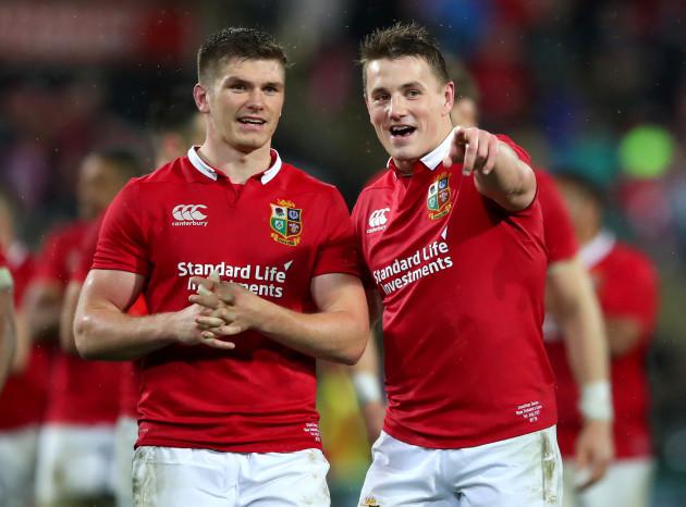 Owen Farrell and Jonathan Davies celebrate winning