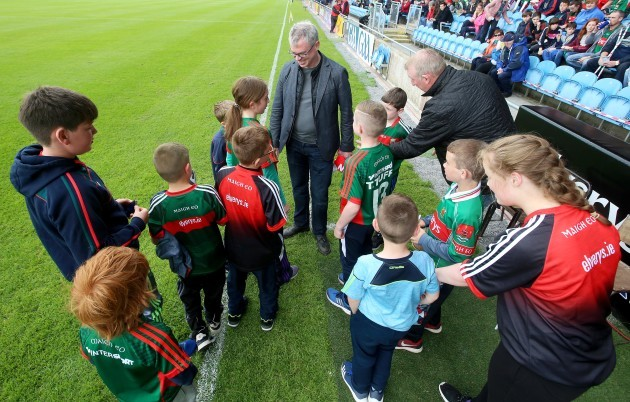 Joe Brolly greets fans before the game