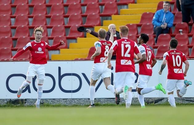 Kieran Sadlier celebrates scoring their first goal from a penalty