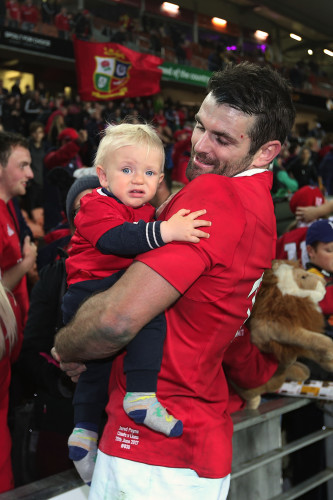 Jared Payne celebrates winning with his son Jake