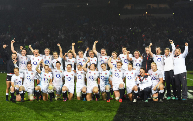 The England team celebrate winning