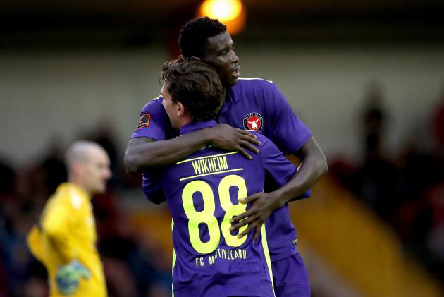 Paul Onuachu celebrates scoring with Gustav Wikheim