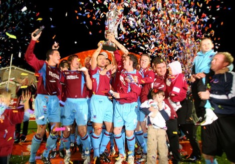 Drogheda players celebrate