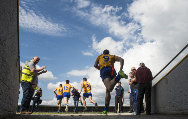 The Clare team run onto the pitch