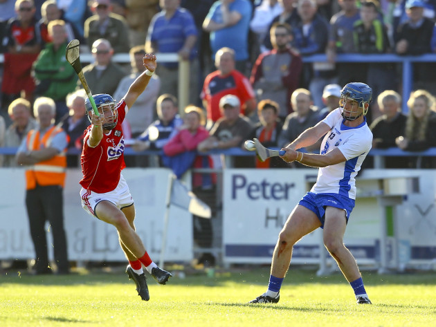 Patrick Curran shoots under pressure from Paul Leopold