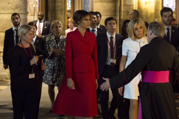 Melania Trump and Brigitte Macron arrive to visit Notre Dame Cathedrale - Paris