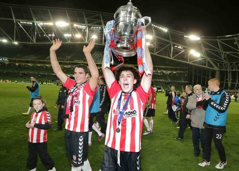 Barry McNamee raises the FAI Ford cup