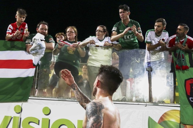 Sean Maguire gives his jersey to a young fan after playing his last game for the club