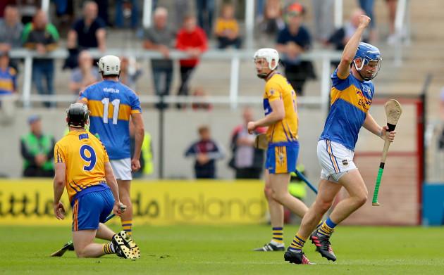 Tony Kelly looks on as John McGrath celebrates scoring a point