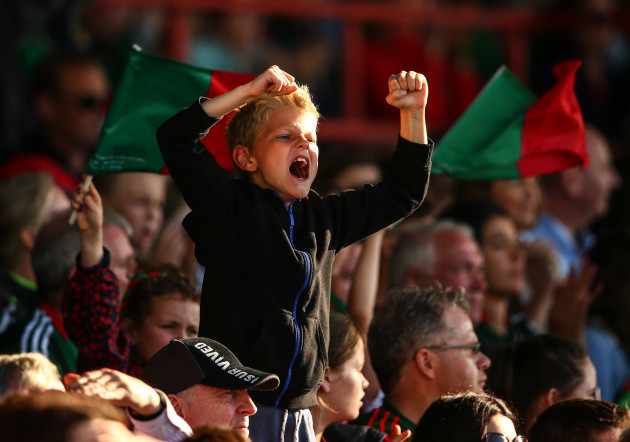 A young Mayo supporter celebrates a score