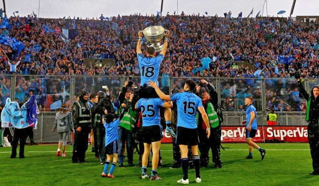 Alan Brogan celebrates with the Sam Maguire trophy in front of Hill 16