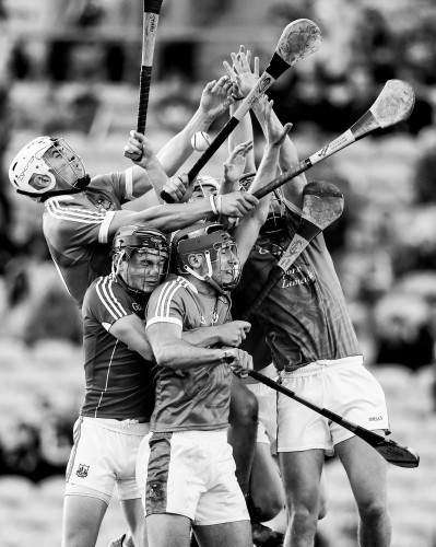 Limerick and cork players compete for the ball