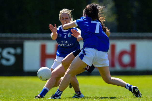 Ciara Blundell scores a goal despite the tackles of Mona Sheridan and Sheila Reilly