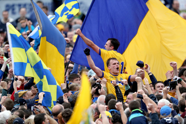 Enda Smith and Donal Smith celebrate with supporters in the crowd after the game