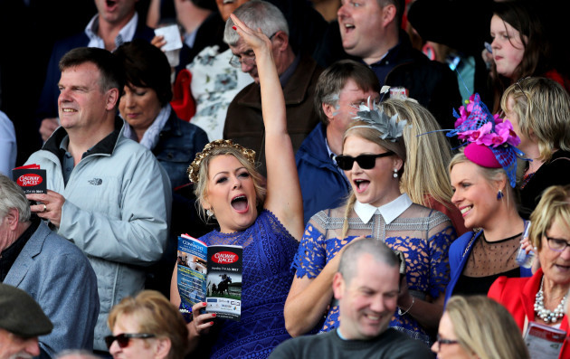 A punter celebrates a winner at the races