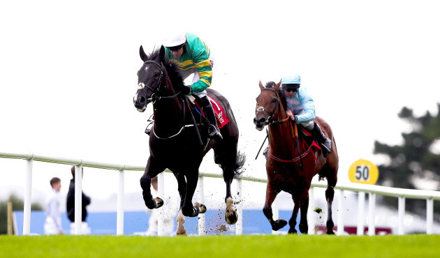 Barry Geraghty on board Le Richebourg wins the opening race ahead of Andrew Lynch on board Twobeelucky