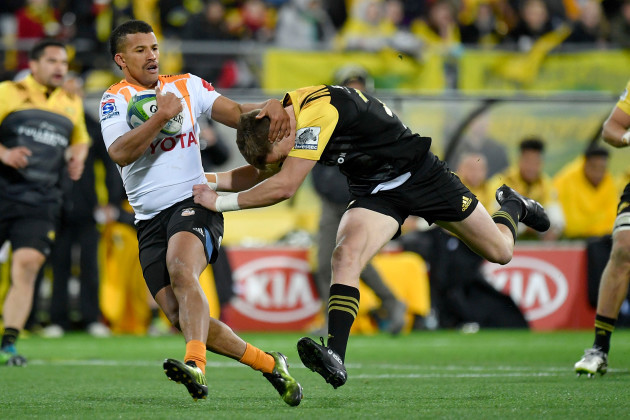 Carl Wegner is tackled by Beauden Barrett