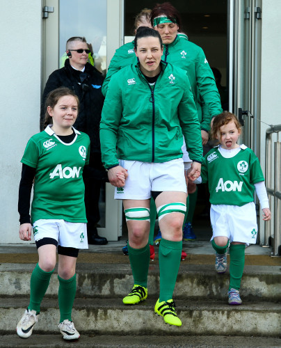 Paula Fitzpatrick leads the team out with the two mascots