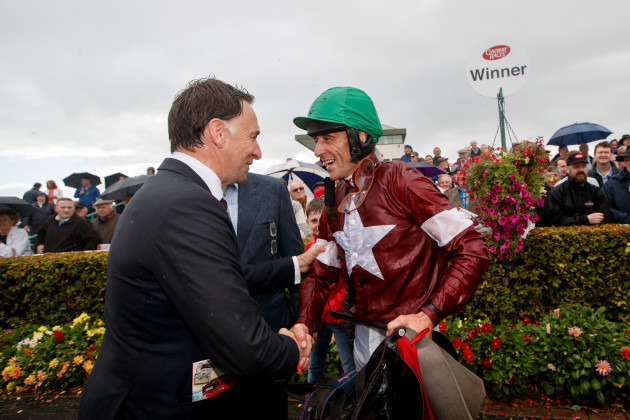 Davy Russell celebrates with his trainer Henry de Bromhead after he won with Balko Des Flos