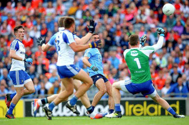 Rory Beggan saves a James McCarthy goal effort