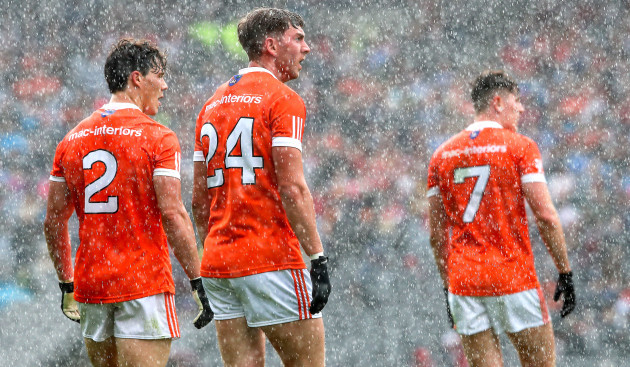 James Morgan, Anthony Duffy and Joe McElroy look on dejected as Tyrone score a late point