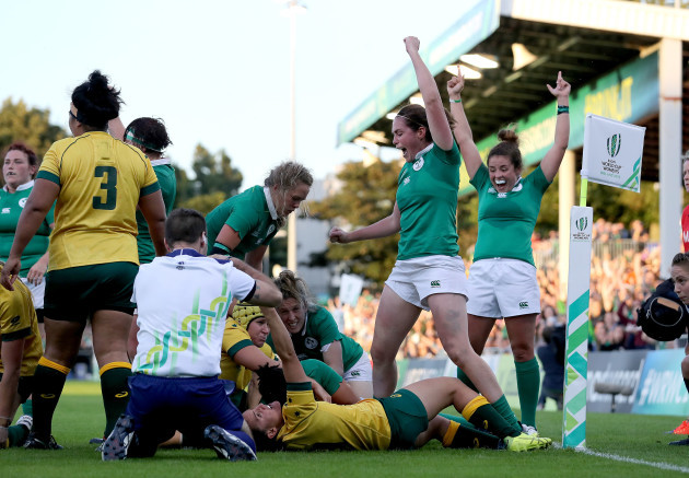 Sophie Spence scores their third try as Nora Stapleton and Larissa Muldoon celebrate