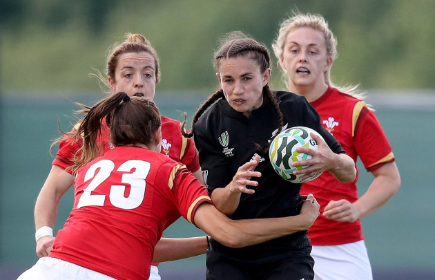 Selica Winiata is tackled by Jodie Evans