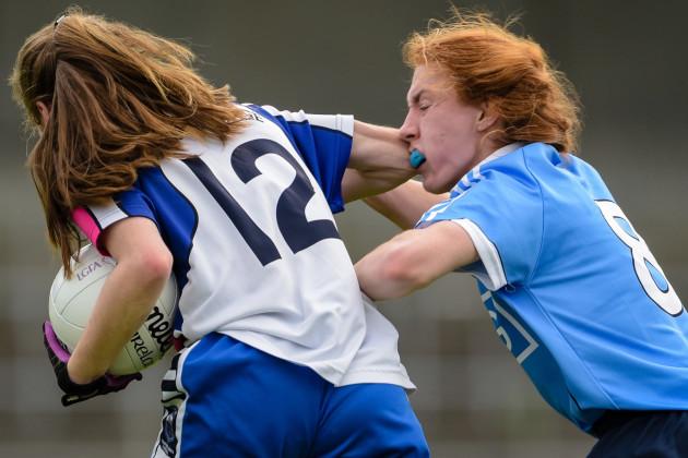 Lauren Magee receives an elbow from Katie Murray