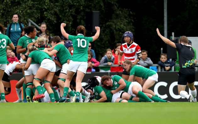 Ireland players celebrate the score of their second try