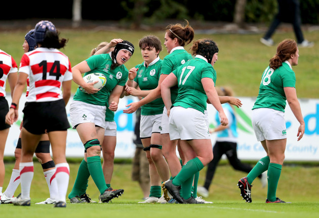 Paula Fitzpatrick celebrates her try with teammates