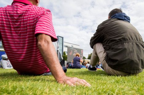 Fans watch the match in the Fanzone