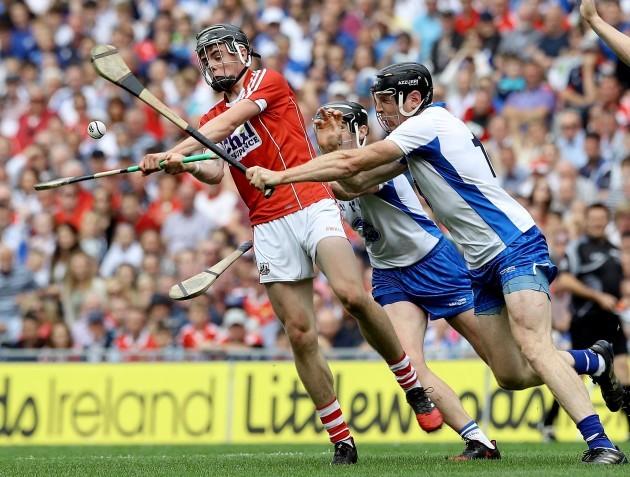 Darragh Fitzgibbon blocked by Kevin Moran