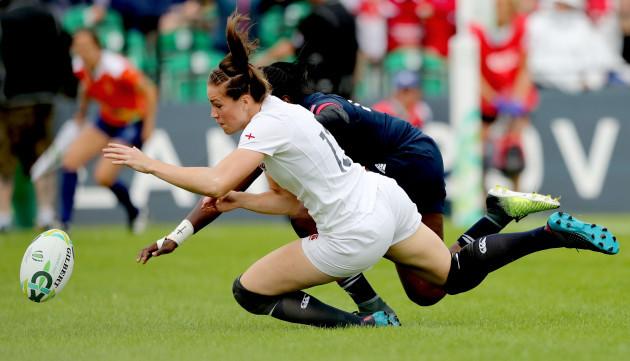 Emily Scarratt scores her sides opening try despite the efforts of Cheta Emba