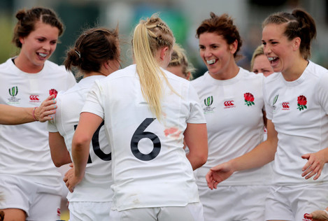 England's players celebrate with try scorer Katy Mclean
