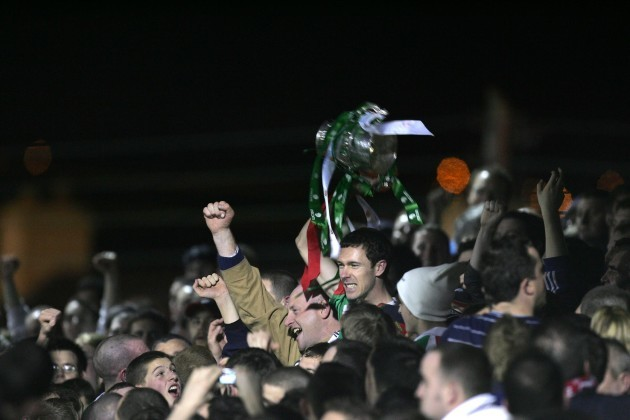 Cork's George O'Callaghan celebrates winning the league with the fans in the Shed End