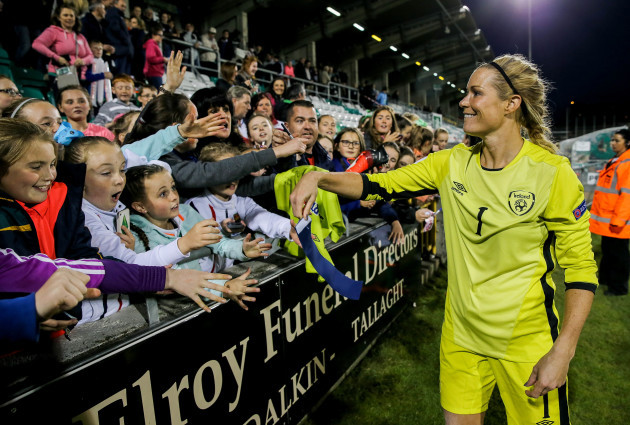 Emma Byrne gives her captain's armband to young fans