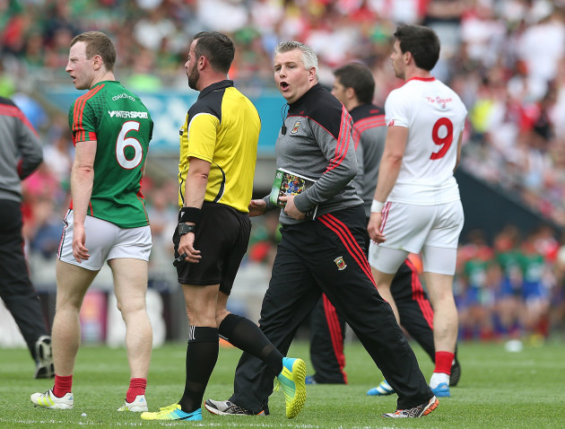 Stephen Rochford tries to speak to referee David Gough at half time