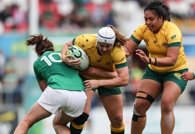 Sharni Williams is tackled by Nora Stapelton