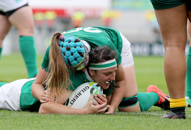 Paula Fitzpatrick scores their fourth try and celebrates with Anna Caplice