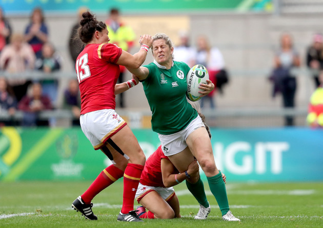 Alison Miller is tackled by Gemma Rowland and Jasmine Joyce