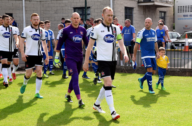 Chris Shields leads his side out