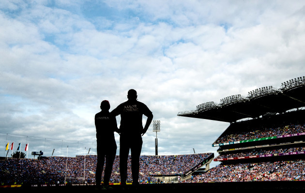 Mickey Harte and Greg Devlin look on in the closing stages