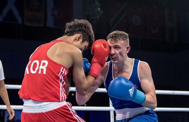 Brendan Irvine in action against Inkyu Kim