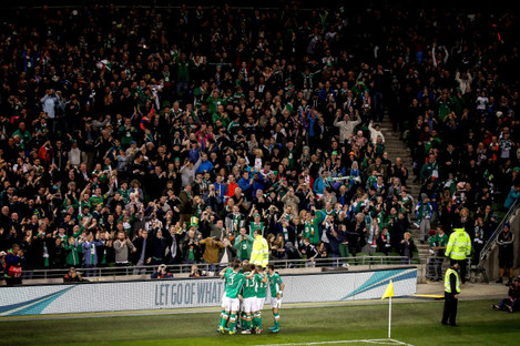 Ireland celebrate as Seamus Coleman scores a goal