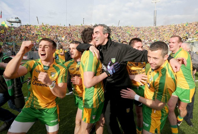 Jim McGuinness celebrates with players after winning the Sam Maguire