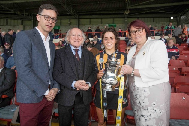Kilkenny captain Meighan Farrell with the Division 1 trophy alongside John Goodwin (Littlewoods Ireland), President Michael D.Higgins and Camogie President, Catherine Neary