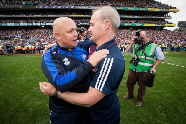 Derek McGrath and Michael Donoghue embrace after the game